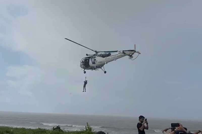 An Indian Coast Guard helicopter on Friday morning rescues a crewman of a minibarge which broke from its mooring and hut the rocks off Palghar coast, sparking a huge security scare on Thursday.
